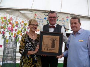 Rayne Stroebel, the Eden Alternative Regional Co-ordinator: South Africa (centre), presents an official Eden plaque to Rae Brown, Rand Aid CEO (right), and Zabeth Zühlsdorff, Rand Aid GM: Services and Advance Division
