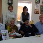 Pat and Frank Lucas (centre) with son Mark on the left, David on the right, and great grand-daughter Amelia on Pat's knee. Standing at the back are daughters Jill and Lynda.